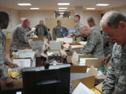 Soldiers Opening Care Packages